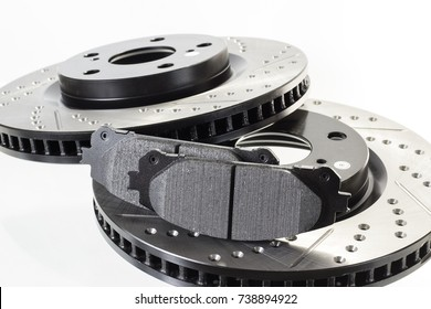 brake disc, pad and reinforced brake hose on a white background
