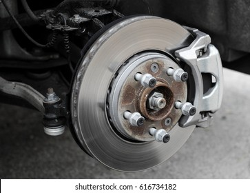 Brake disc and used brake pads on old car stock photo