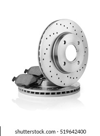 Brake discs and brake pads on white