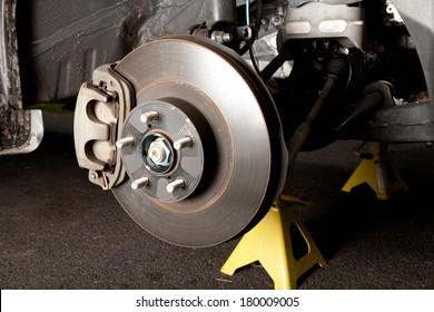 Brake disk and caliper assembly on a modern car about to be replaced