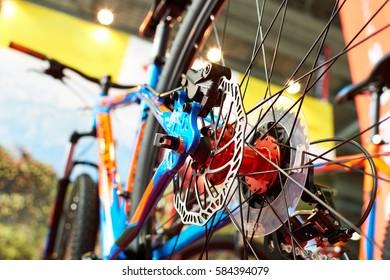 Brake disk of rear wheel sport mountain bike in shop closeup