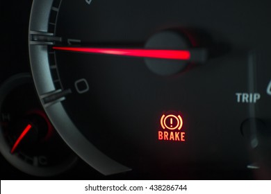 Brake light signal icon on the car panel, Close-up and Soft-focus