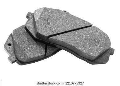 Brake pads isolated on white background. Auto parts. Brake pads isolated on white. Braking pads. Car part. Car detailing. Spare parts