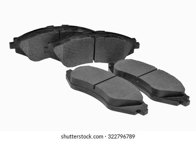 brake pads on a white backgrounda set of new brake pads isolated on white background