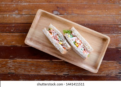 Brakfast and sandwich on table