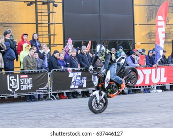 Braking on the front wheel. St. Petersburg Russia - 15 April, 2017. International Motor Show IMIS-2017 in Expoforurum. Sports motorcycle show of bikers on the open area.