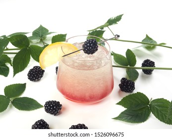 Bramble cocktail. A gin sour cocktail spiked with an eye-catching shot of blackberry liqueur