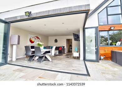 Bramcote, Nottinghamshire, UK, 05/26/2016, Folding doors on a modern bespoke architect designed home