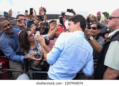 BRAMPTON- SEPTEMBER 15 :Prime Minister Justin Trudeau shaking hands with his supporters during a community BBQ  event organized by the Liberal Party of Canada on September15, 2018 in Brampton, Canada.