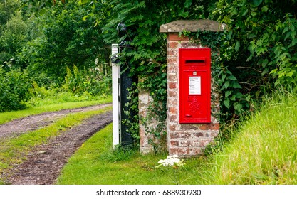 Brampton, UK - July 10, 2017: Rural post box set into a brick gate post in the countryside of Cumbria, UK.