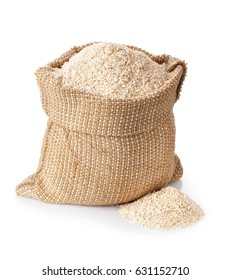 bran in burlap sack and scattered heap near isolated on white background. Food supplement to improve digestion. Dietary fiber. Product for healthy nutrition and diet