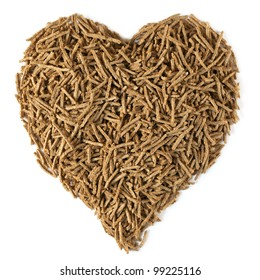 Bran in a heart shape, isolated on white.  Dietary fiber is beneficial for heart health.