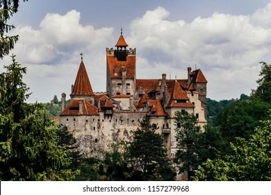 Bran, Transylvania region / Romania - June 10 2018: famous medieval castle Bran in the Carpathian Mountains, Transylvania, Romania. The legendary residence of Count Dracula, Vlad Tepes