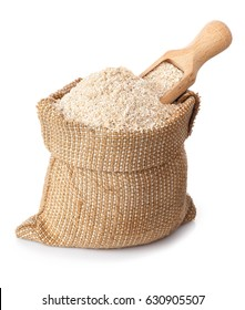 bran and wooden scoop in bag isolated on white background. Product for healthy nutrition