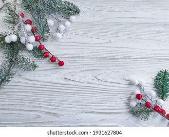 branch of a christmas tree on a wooden background