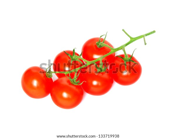 Branch of five cherry tomatoes isolated over white background