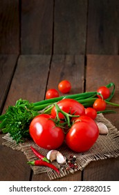 Branch of fresh tomato on  wooden background