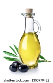 Branch with olives and bottle of virgin olive oil