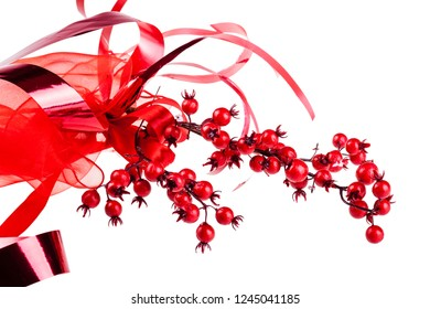 a branch of red christmas berry isolated on a white background