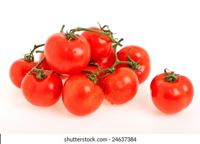 Branch of red, ripe tomatoes of the small size