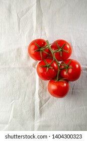 Branch of red tomatoes above