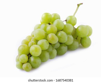 Branch of ripe green grapes isolated on a white background