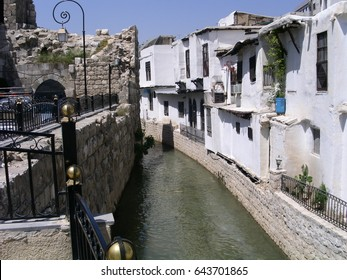 A branch of the river Barada in old city of  Damascus, Syria