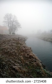 Branch of river in the fog