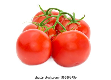Branch with the several ripe red tomatoes closeup on a light background