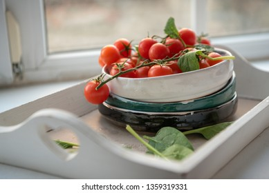 Branch of tomatoes on a plate with spinach