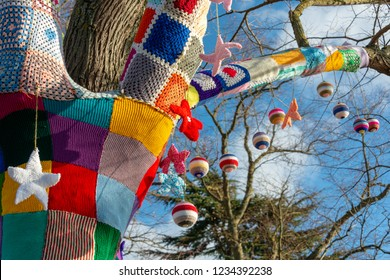 branch of tree with Christmas knitted yarn bomb