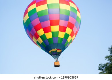 Branchburg, New Jersey / United States - July 28, 2018: A hot air balloon gets ready to land near the Midland School after launching at the Quick Chek Festival of Ballooning.