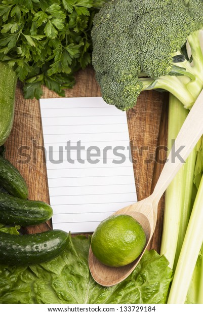 branches of cabbage of a broccoli on a blank sheet of a writing-book