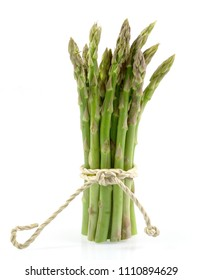 branches of fresh green asparagus isolated on white background, with clipping path.