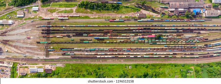 Branches of the railway at the marshalling yard, a lot of freight wagons from the height.