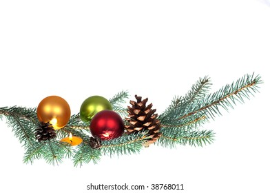 Branches of a tree with Christmas balls, a pine cone and candle on it