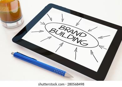Brand Building - text concept on a mobile tablet computer on a desk - 3d render illustration.