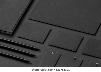 Brand identity mockup. Blank corporate stationery set at black textured paper background.