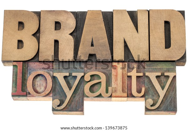 brand loyalty - business concept - isolated text in letterpress wood type printing blocks