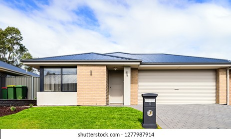 Brand new Australian median house with double garage door, landscaping and mailbox at front