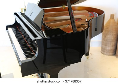 Brand new baby grand piano and keyboard.