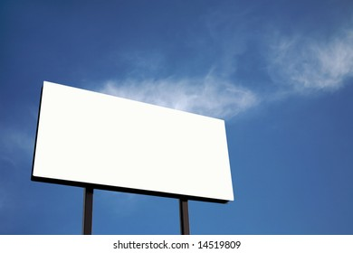 Brand new billboard in blue sky with clouds