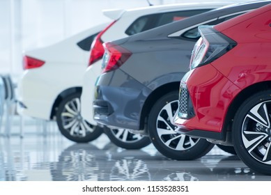 Brand new cars in stock Showroom floors are epoxy for parking in new car showrooms for sale at car dealerships.