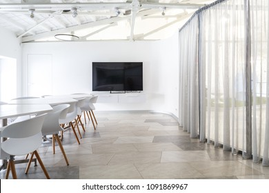 Brand new designed office interior in hi tech stile. Many steel, glass and natural wood elements, white walls and ceilings.