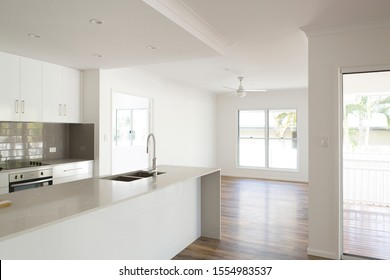 The brand new house keys have been handed over, time to move in. White cabinetry, white walls, hartford vinyl plank flooring, grey alpine mist stone bench tops and grey subway tiles.