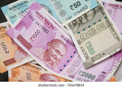 The brand new Indian currency bank notes of 50, 200, 500 and 2000 rupees bundle. Success and got profit from business. GST tax on goods and service. Rise in oil price