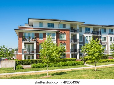 Brand new low rise apartment building on sunny day in British Columbia, Canada