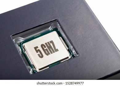 Brand new modern no name silver cpu 5 ghz processor die, chip plastic packed top lid view macro closeup. New tech prop, fast futureproof professional gaming productivity processing unit concept