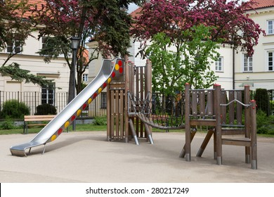Brand new modern wooden and metal playground with slider and shaking bridge for children in Warsaw, Poland