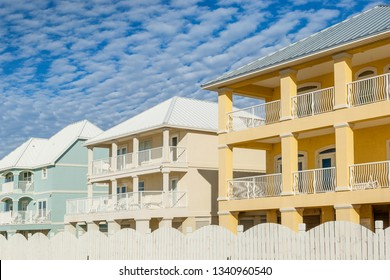 Brand new oceanfront multicolored vacation homes on the white sandy beach of Gulf of Mexico, Alabama, USA